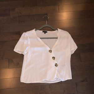 White T-shirt with Asymmetrical Buttons